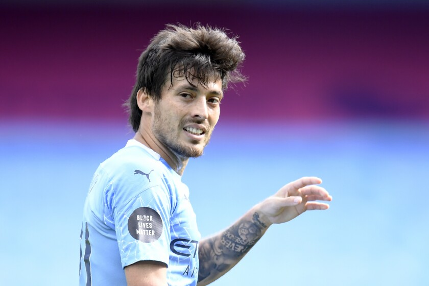 Manchester City's David Silva walks on the pitch during the English Premier League soccer match between Manchester City and Norwich City at the Etihad Stadium in Manchester, England, Sunday, July 26, 2020. (Peter Powelll/Pool via AP)