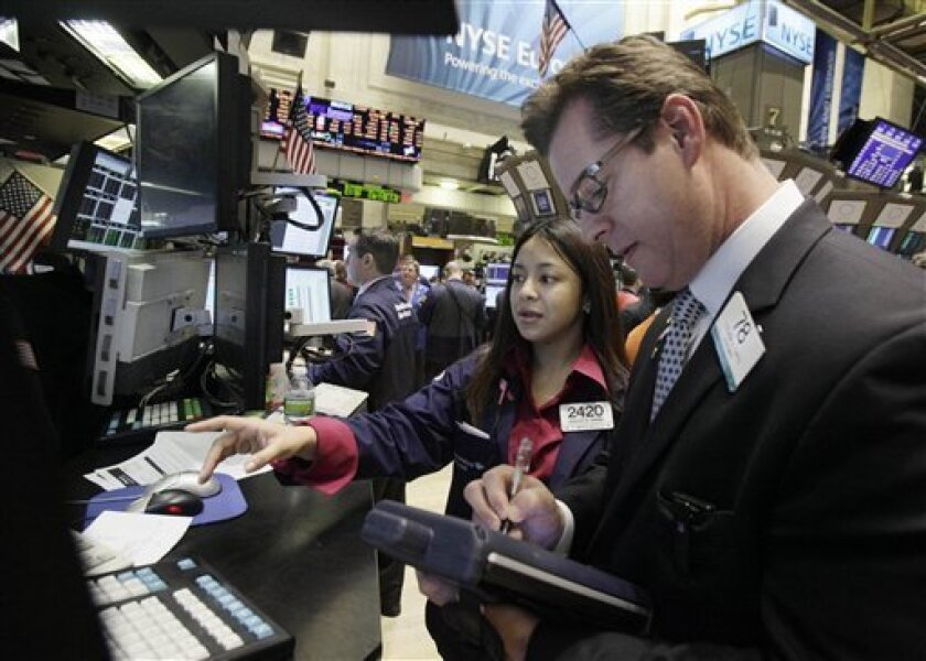 In this Feb. 25, 2011 photo, specialist Wingszi Chiang, left, works at her post on the floor of the New York Stock Exchange. (AP Photo/Richard Drew)