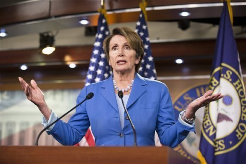 House Minority Leader Nancy Pelosi of Calif. gestures during a news conference on Capitol Hill in Washington, Friday, Aug. 2, 2013, where she told reporters that Congress has too much critical, unfinished work to be leaving for a five-week recess. (AP Photo/J. Scott Applewhite)