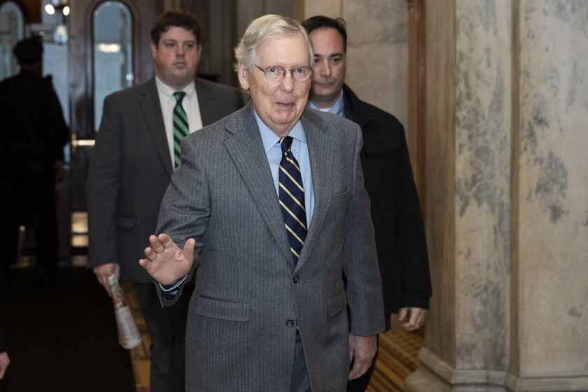 Senate Majority Leader Mitch McConnell of Ky., waves as he arrives on Capitol Hill, Monday, Feb. 3, 2020 in Washington. (AP Photo/Alex Brandon)