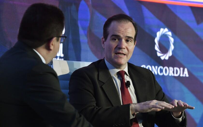 Caracol TV journalist Ricardo Ospina, left, and Mauricio Claver-Carone, senior director at the National Security Council.
