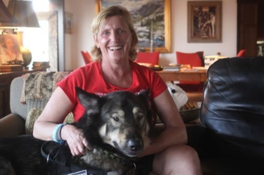 La Jolla resident Beverly Bica and her service dog, Branson. Ashley Mackin