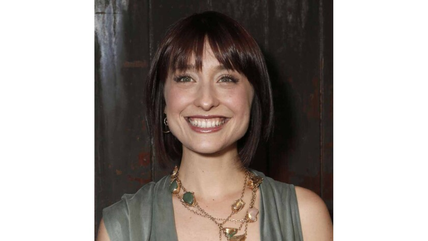 """Federal prosecutors say """"Smallville"""" actress Allison Mack, seen on June 26, 2012, has been charged with sex trafficking for helping recruit women to be slaves of a man who sold himself as a self-improvement guru."""