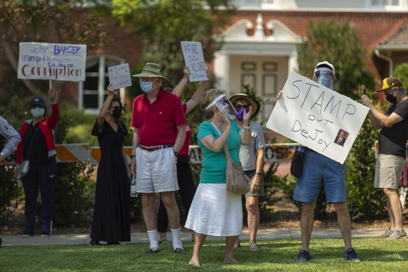 Protesters rally outside the home of USPS Board of Governors John M. Barger