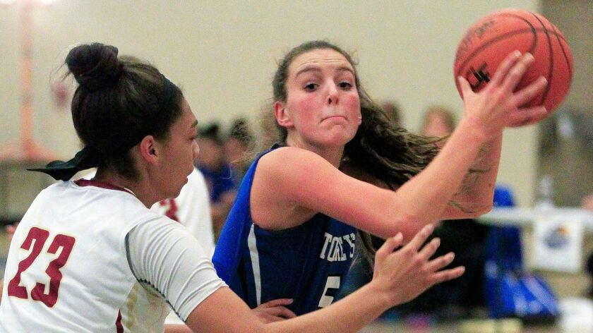 La Jolla Country Day's Bianca Notarainni looks up to shoot as Mission Hills' Aaliyah Taylor defends.