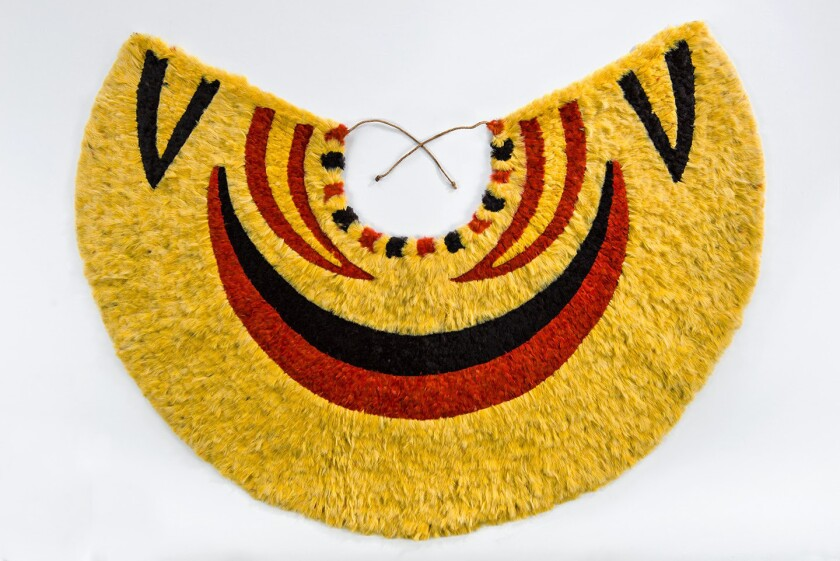 """A feather cape on view at LACMA as part of the exhibition """"Royal Hawaiian Featherwork."""""""