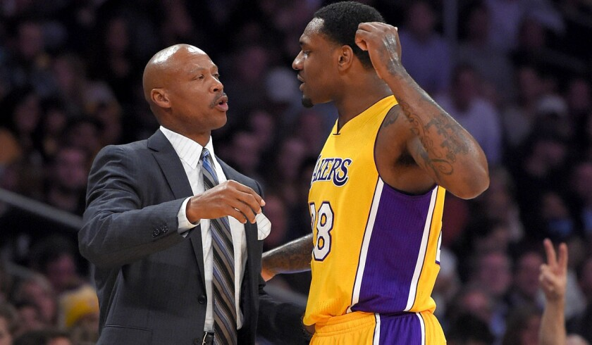 Lakers Coach Byron Scott talks with forward Tarik Black during the second half of their 101-84 victory over the Orlando Magic on Friday night at Staples Center.
