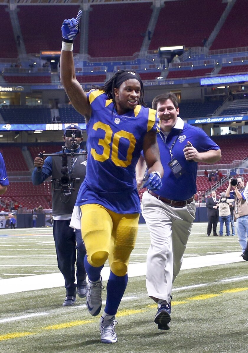 St. Louis Rams running back Todd Gurley celebrates as he runs off the field following an NFL football game against the San Francisco 49ers, Sunday, Nov. 1, 2015, in St. Louis. The Rams won 27-6. (AP Photo/Billy Hurst)