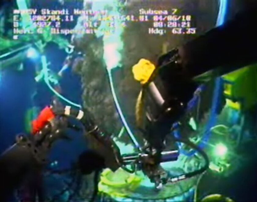An image from video made available by BP PLC shows dispersant being applied to an oil leak during efforts to cap the Deepwater Horizon oil well in the Gulf of Mexico Thursday June 3, 2010. The white wand in the center is releasing the dispersant.(AP Photo/BP PLC) NO SALES