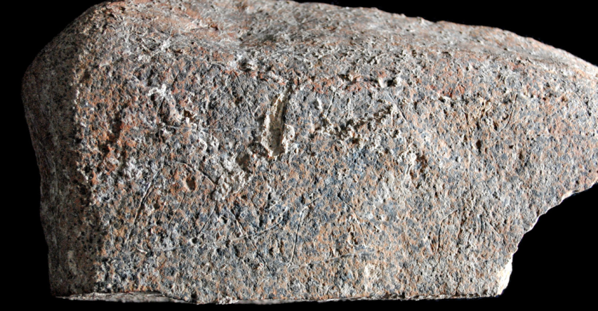 A stone slab 7 inches long, and engraved 13,800 years ago, may be one of the earliest known depictions of a human campsite.