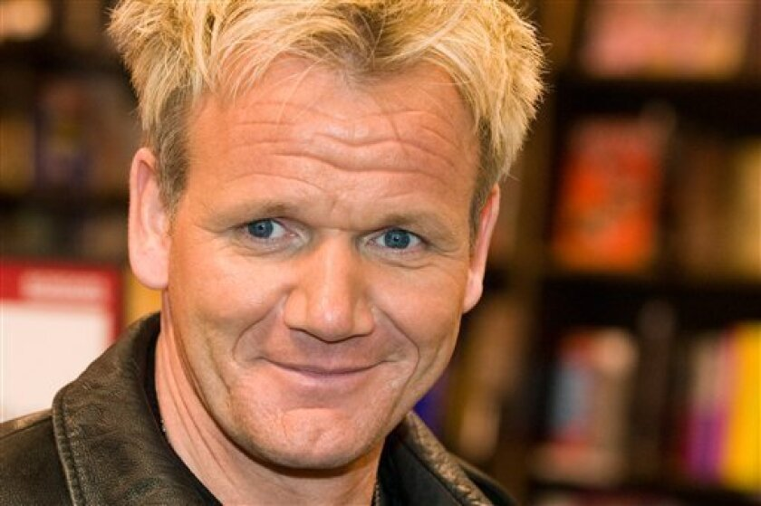 """FILE - In this Feb. 10, 2009 file photo, chef Gordon Ramsay signs his book """"Healthy Appetite"""" at Borders Books in New York. (AP Photo/Charles Sykes, File)"""