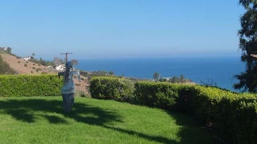 The home sits on a hilltop of about three acres with a view of Billionaires' Beach.