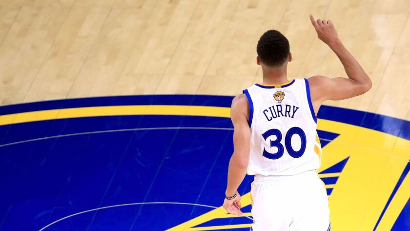 OAKLAND, CA - JUNE 01: Stephen Curry #30 of the Golden State Warriors reacts to a play in Game 1 of