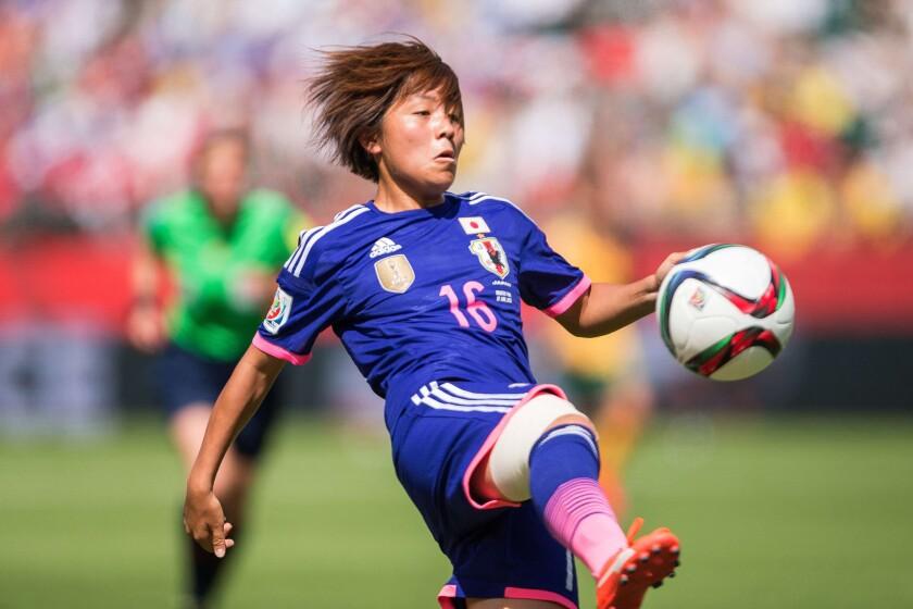 Japan's Mana Iwabuchi kicks the ball during a quarterfinal match against Australia on June 27 in Edmonton, Canada.