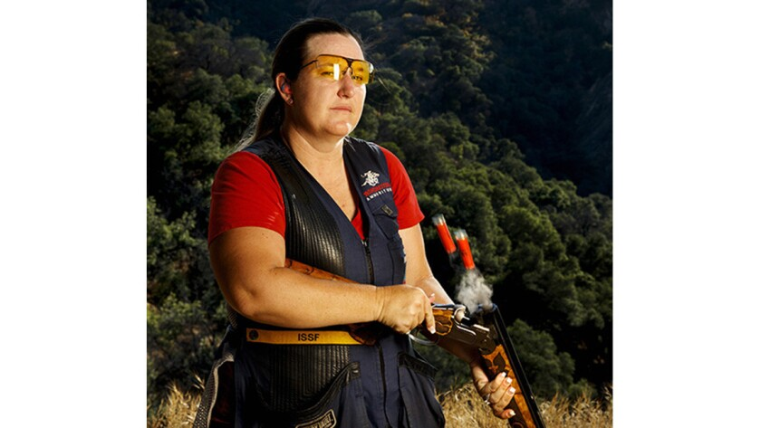 Olympian Kim Rhode posing with her shotgun at Oak Tree Shooting Range on June 20, 2016. Rhode is a five-time Olympic medalist in shotgun and will compete on the U.S.A. shooting team in the 2016 Rio Olympics.