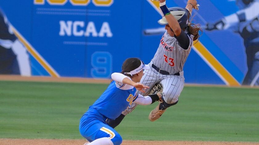UCLA shortstop Briana Perez tags out Fullerton runner Kelsie Whitmore before she steals second base