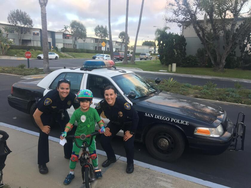 POLICE PALS: These two San Diego police officers, Sarah Sutter and Torrie Albini, took a minute last Saturday evening to show my 5-year-old son, Jackson, their car, lights and siren.