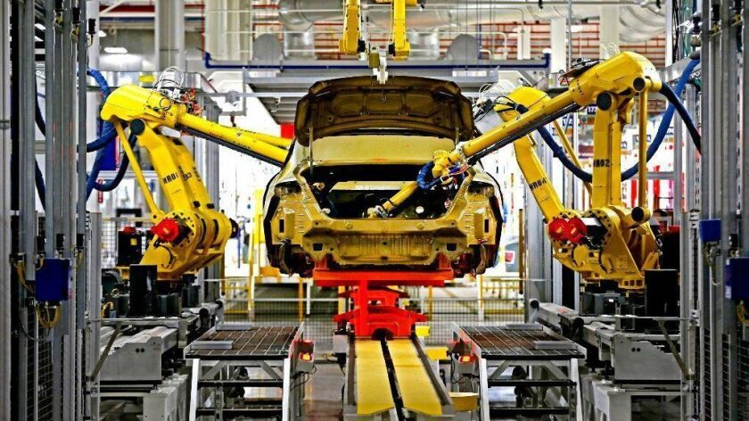 Robots build a Chrysler vehicle at the Sterling Heights Assembly Plant in Michigan in 2014.
