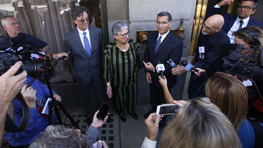 California Air Resources Board Chairwoman Mary Nichols, center, with Cal EPA Secretary Matthew Rodriguez and California Atty. Gen. Xavier Becerra after the first public hearings on the Trump administration's proposal to roll back car-mileage standards.