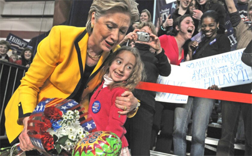 """PROVIDENCE, R.I.: """"I can stand up here and say...let's get unified, the sky will open, the light will come down...But I have no illusions,"""" Clinton said."""