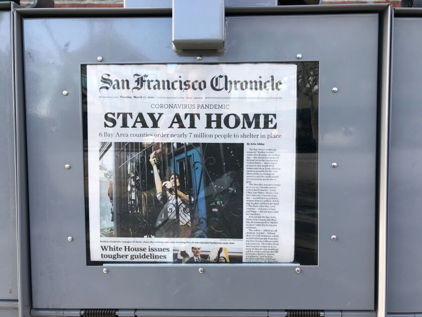 A newsstand displays the front page of the San Francisco Chronicle on Tuesday, March 17, 2020.