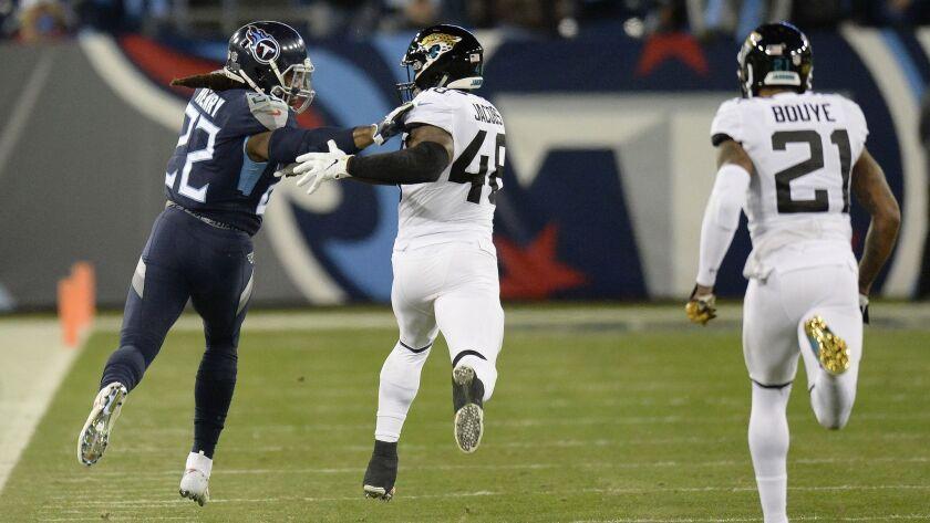 Tennessee Titans running back Derrick Henry (22) runs past Jacksonville Jaguars outside linebacker L