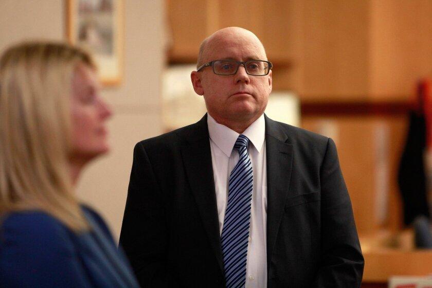 Jeffrey Barton stands in a Vista courtroom