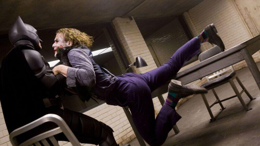 Review Heath Ledger S Joker Inflames A Despairing Dark