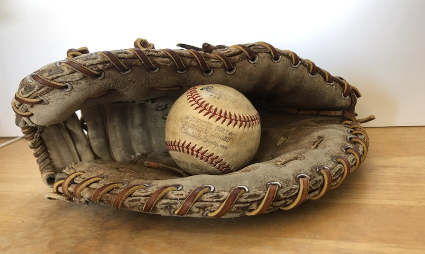 A baseball hit by former Padres pitcher Rollie Fingers during pregame warmups at San Diego Stadium found its way into this glove 42 years ago.