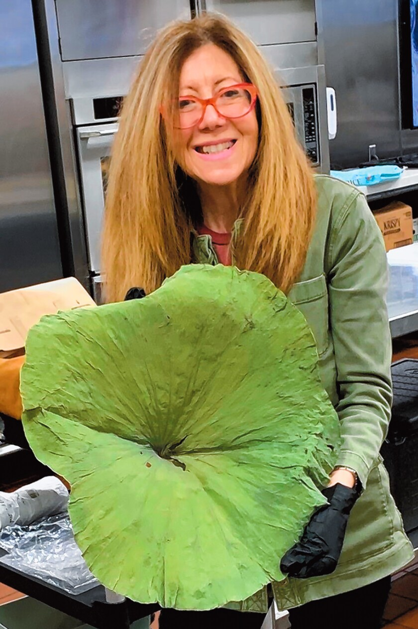 """Kitchen Shrink"" Catharine Kaufman with a lotus leaf"