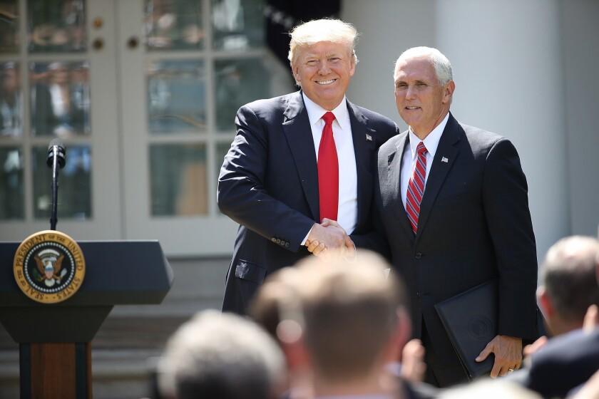 WASHINGTON, DC - JUNE 01: U.S. President Donald Trump greets U.S. Vice President Mike Pence .