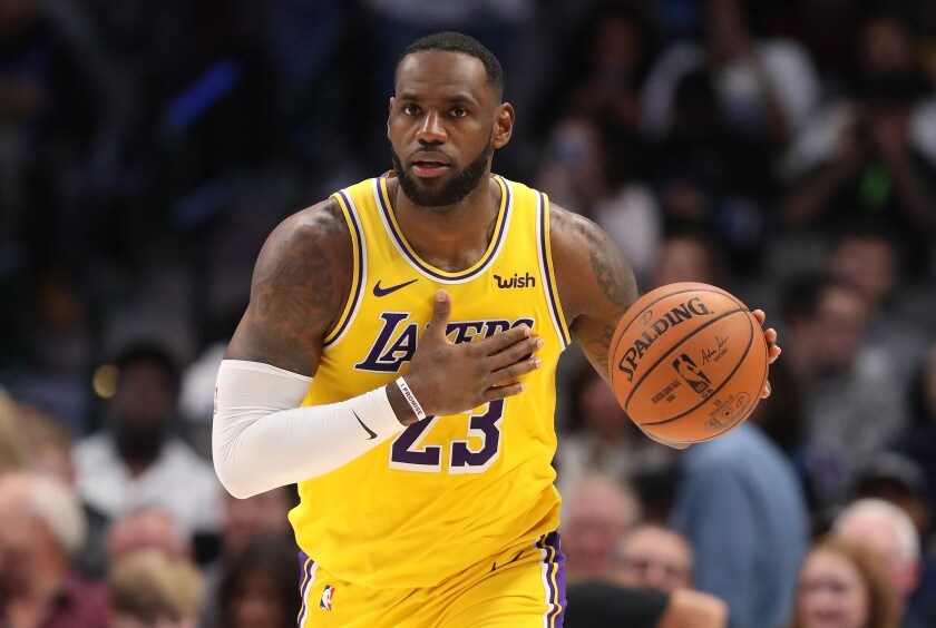 LeBron James wears the Lakers' gold jersey during a road win over the Dallas Mavericks.