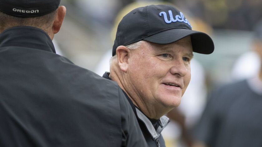 UCLA head coach Chip Kelly roams the field before playing Oregon in an NCAA college football game in