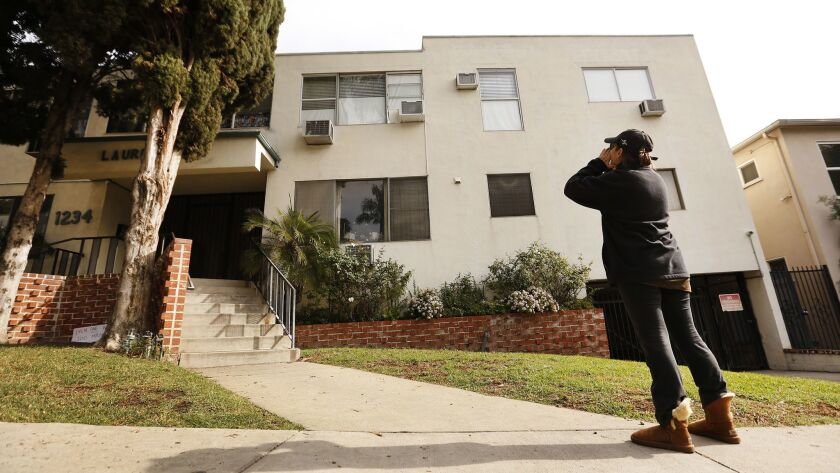 WEST HOLLYWOOD, CA - JANUARY 08, 2019 Neighbor Jackie Tepper, yells at the second floor corner unit