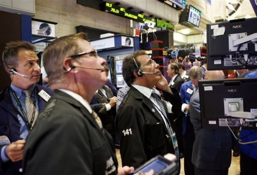 In this Sept. 1, 2010 photo, traders and specialists work the trading floor of the New York Stock Exchange, in New York. (AP Photo/David Karp)