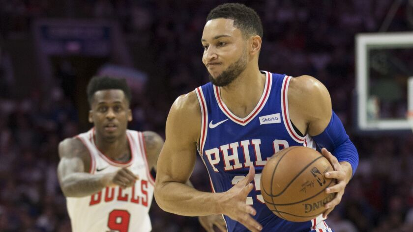 Ben Simmons of the Philadelphia 76ers drives to the basket against Antonio Blakeney of the Chicago Bulls in the first quarter.