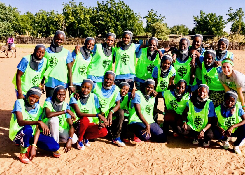 Players gather during the launch of the Darfur United women's team