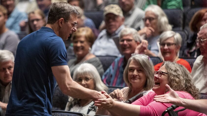 U.S. Rep. Justin Amash, R-Cascade Township, greets the crowd before holding a town hall meeting at G