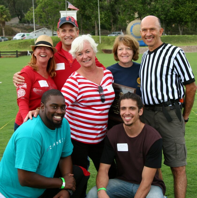 At the Del Mar-Solana Beach Rotary Club Bocce Tournament: upper left, first-place winners Barbara Blakely and Steve Bagwell; bottom, second place winners Marquelle Edwards and Steven Silva; center, in red stripe shirt, sponsor Kitty McGee; upper right, Bocce Chair Vicky Mallett and head referee Pau