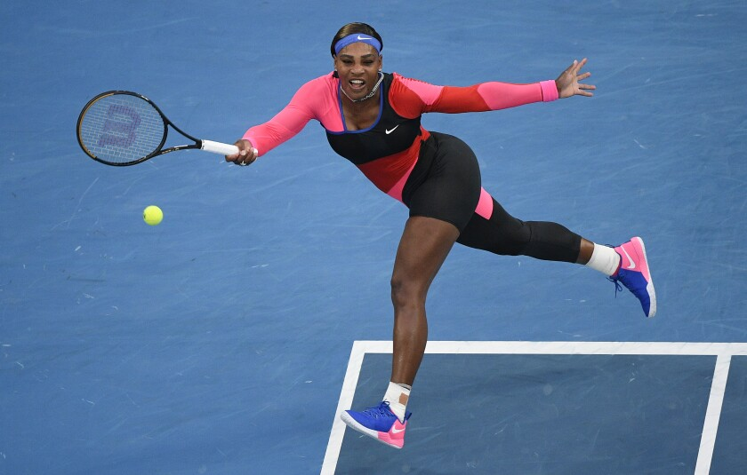 United States' Serena Williams hits a forehand return to Romania's Simona Halep during their quarterfinal match at the Australian Open tennis championship in Melbourne, Australia, Tuesday, Feb. 16, 2021.(AP Photo/Andy Brownbill)