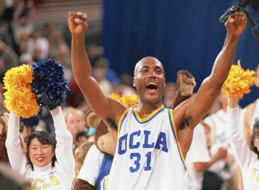 Ed O'Bannon celebrates UCLA's NCAA title victory over Arkansas on April 3, 1995.