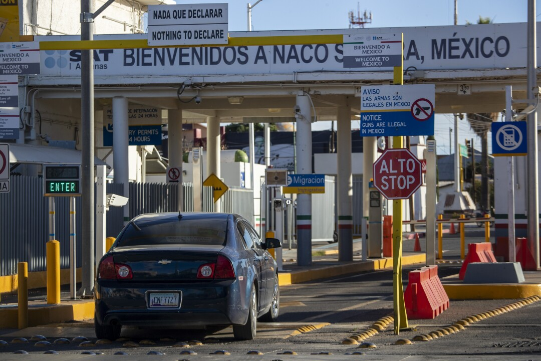 A vehicle drives into the border checkpoint in Naco Sonora in view from Naco, AZ.