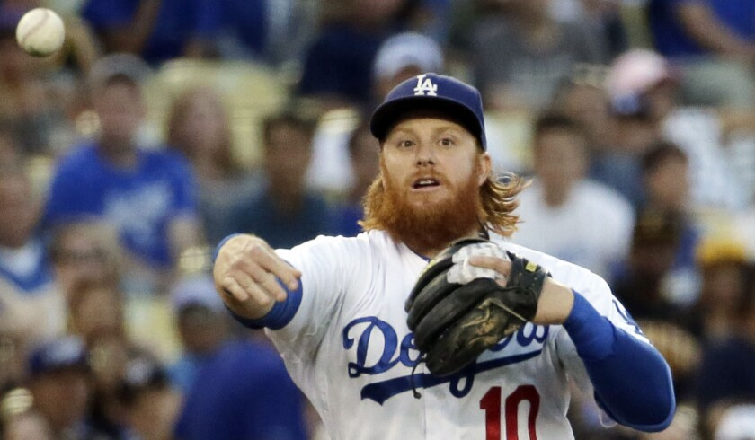 Dodgers third baseman Justin Turner throws to first against Pittsburgh on Saturday night.