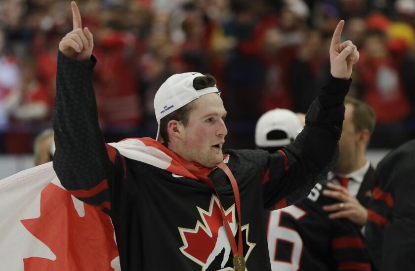 Canada's Alexis Lafreniere celebrates.