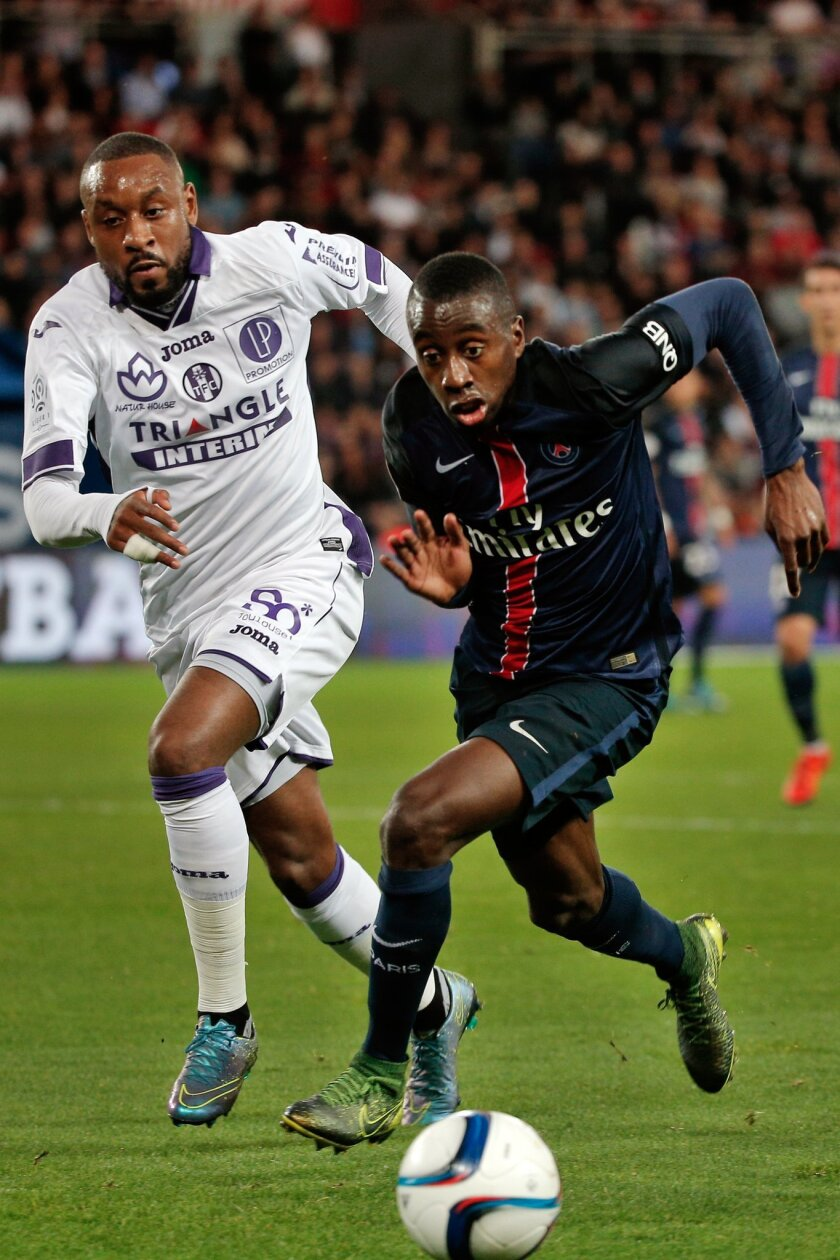 PSG's Blaise Matuidi, right, challenges for the ball with Toulouse's Jean Armel Kana Biyik, during their French League One soccer match, at the Parc des Princes stadium in Paris, France, Saturday, Nov. 7, 2015. (AP Photo/Thibault Camus)
