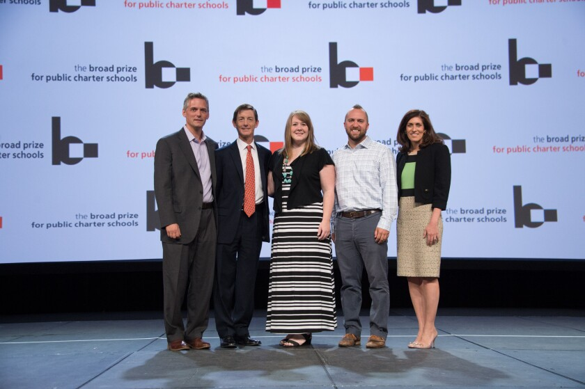 Bruce Reed, second from left, and Nina Rees, right, congratulate KIPP Foundation representatives Stephen Mancini, left, Carissa Godwin, third from left, and Eric Schmidt, second from right.
