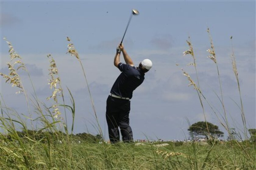 Graeme McDowell, of Northern Ireland, hits from the fourth tee during the first round of the PGA Championship golf tournament on the Ocean Course of the Kiawah Island Golf Resort in Kiawah Island, S.C., Thursday, Aug. 9, 2012. (AP Photo/Chuck Burton)