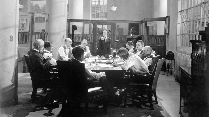 Smouldering Fires (1925) Directed by Clarence Brown Shown standing: Pauline Frederick; seated to the