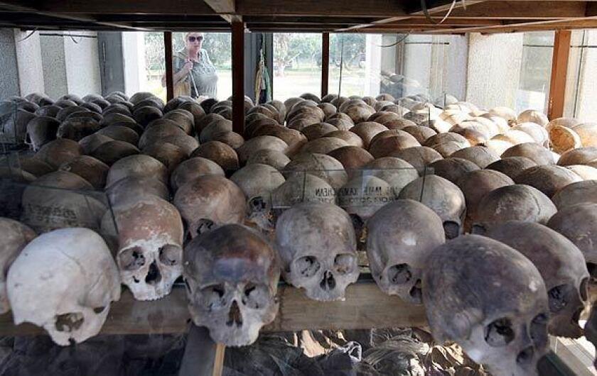 Skulls of Khmer Rouge victims on display at Choeung Ek Genocidal Center outside Phnom Penh, Cambodia.