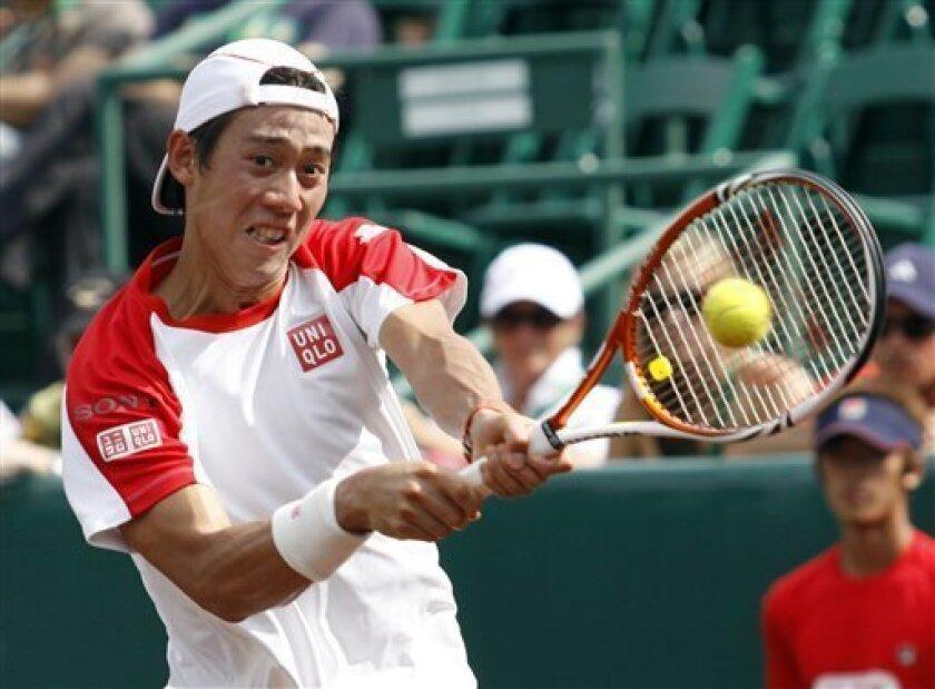 Kei Nishikori, of Japan, returns a shot to Pablo Cuevas, of Uruguay, in the semifinals at the U.S Men's Clay Court Championship tennis tournament Saturday, April 9, 2011, in Houston. Nishikori won 6-3, 7-5. (AP Photo/Eric Kayne)